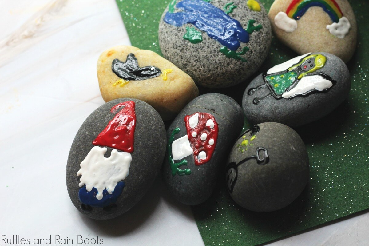 close up of garden gnome story stones on tabletop and green cloth
