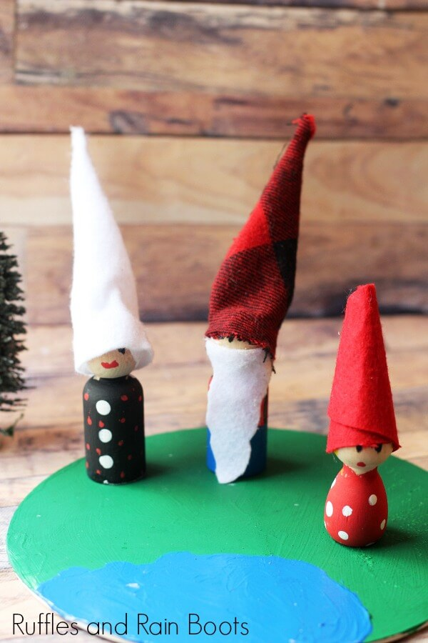 Montessori gnomes completed and standing on painted ground