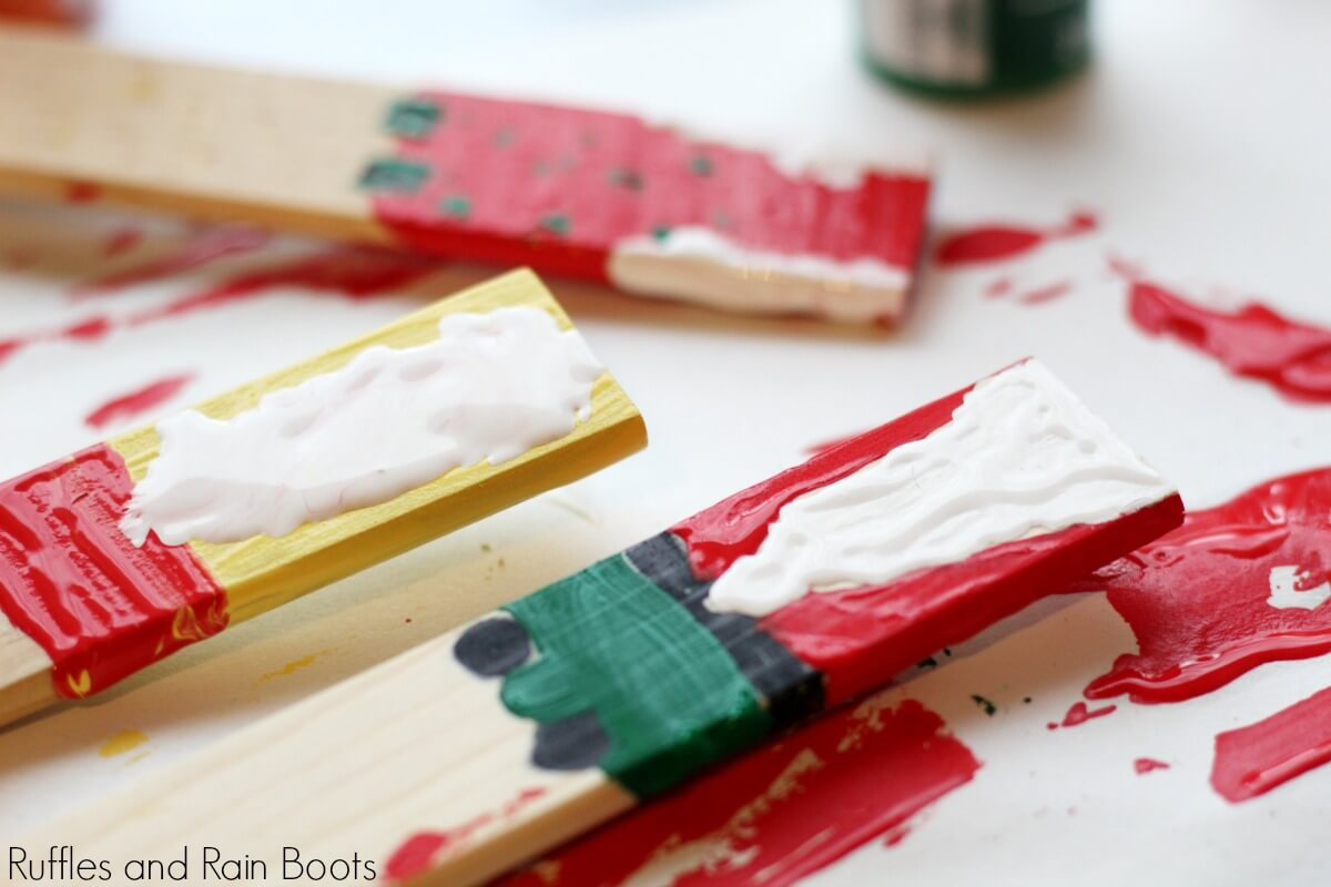 painting the gnome craft for kids and letting it dry