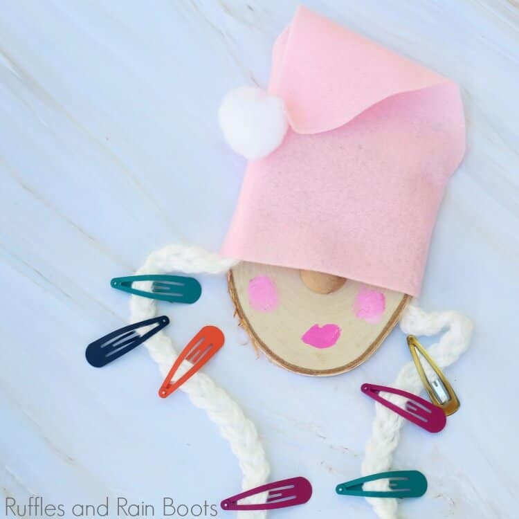 close up of gnome barrette holder with several barrettes hanging on to it
