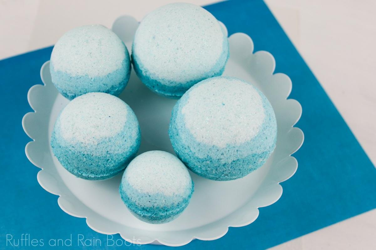 queen elsa bath bombs on a white plate on a blue background
