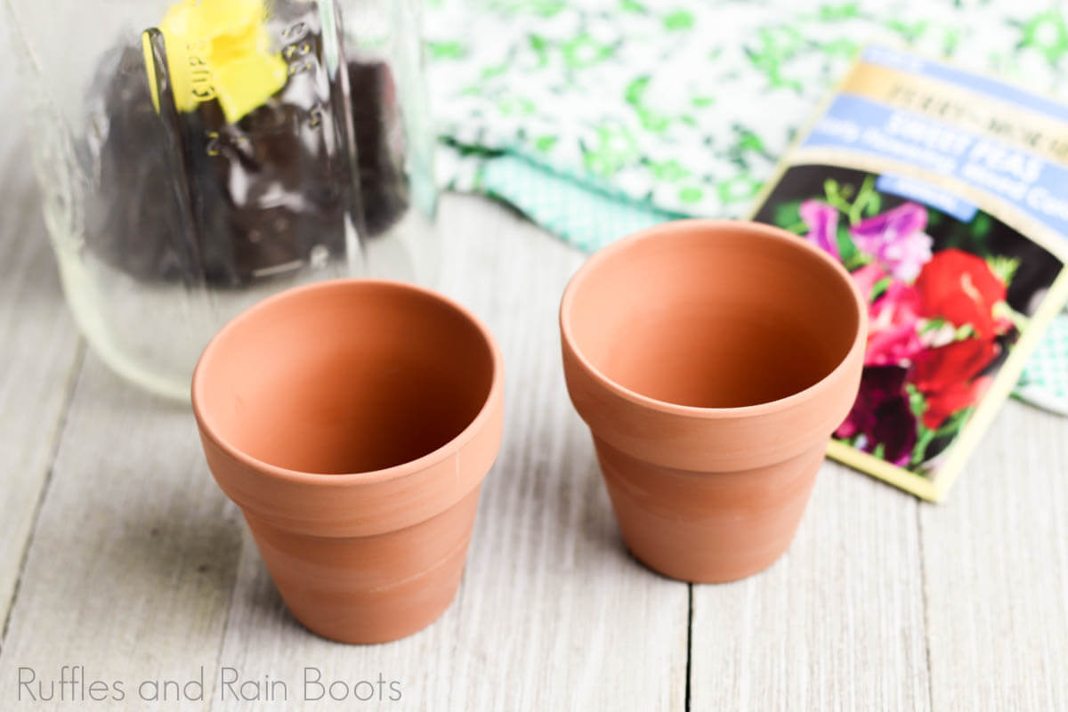 flower date night in a jar step of adding mini clay pots to the jar