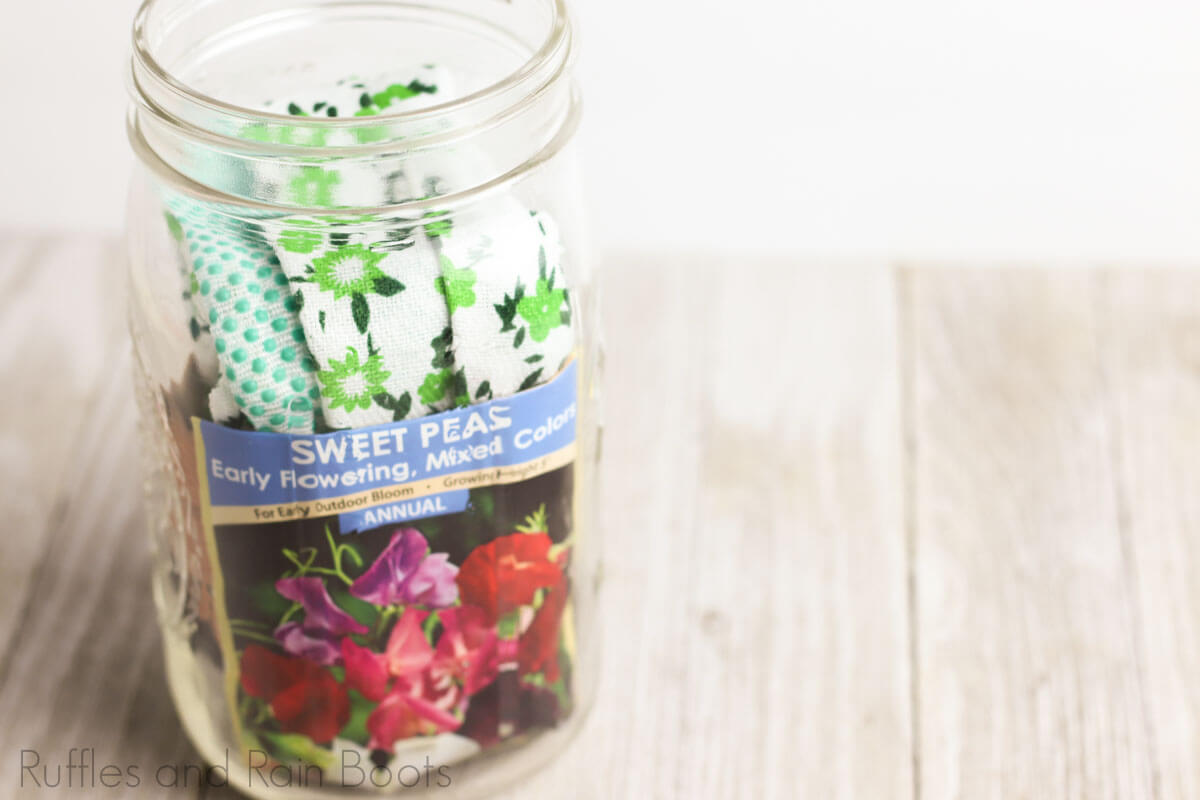 flower date night in a jar step of placing gloves into the jar