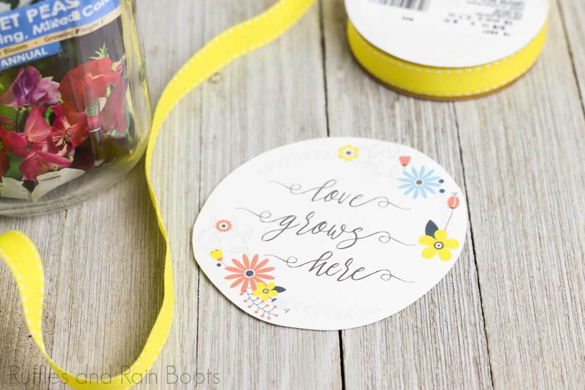 flower date night in a jar step of adding ribbon and tag to the jar