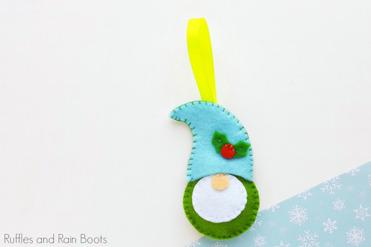 free pattern for felt gnome ornament on a white and blue background
