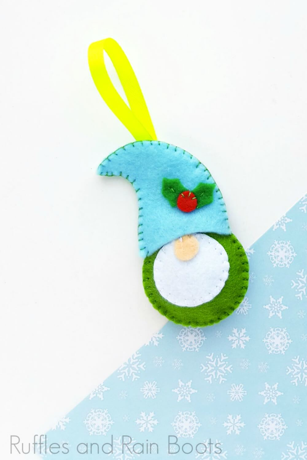 felt gnome ornament pattern on a white and blue background