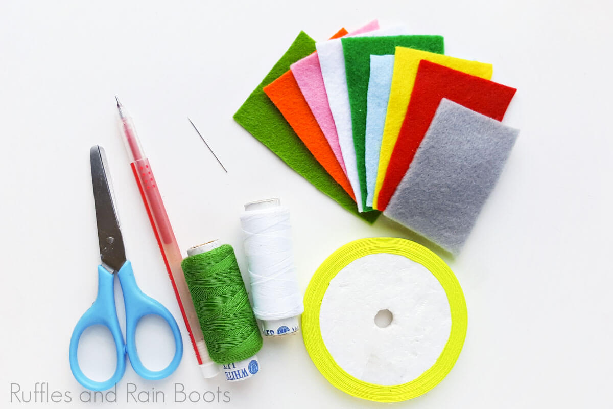 supplies for felt gnome ornament on a white background