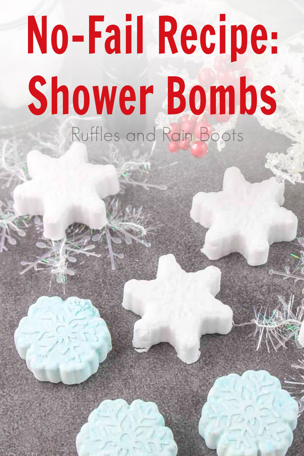 no fail shower bomb recipe shaped like snowflakes on a grey background with text which reads no-fail recipe: shower bombs