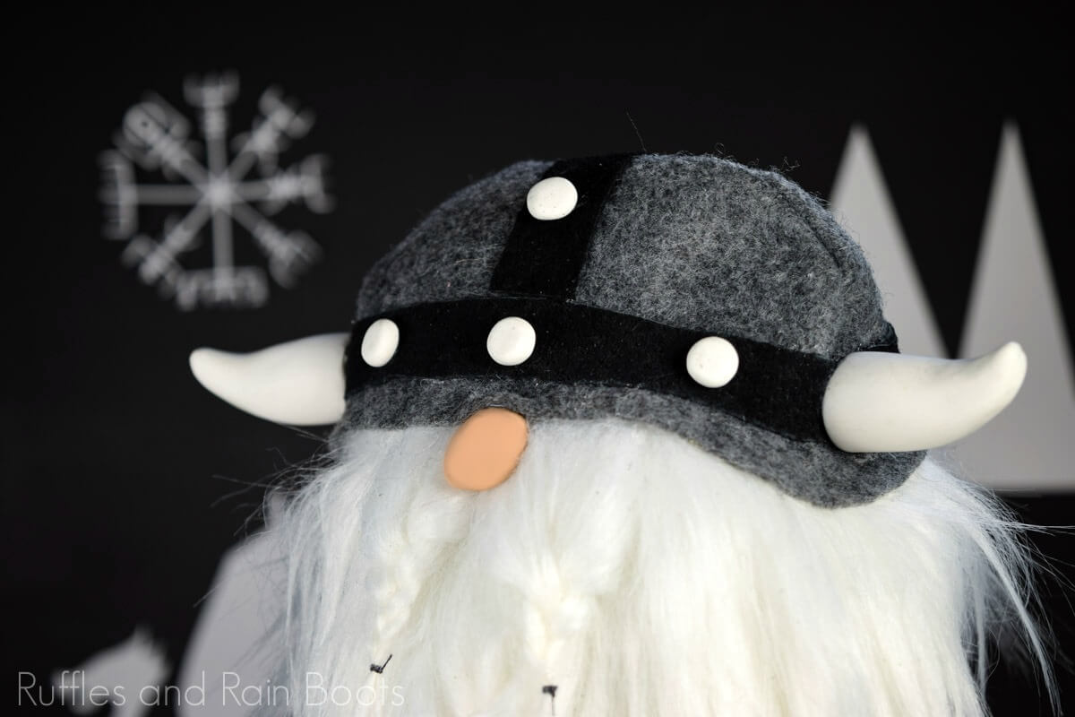 Viking gnome with gray helmet on black background
