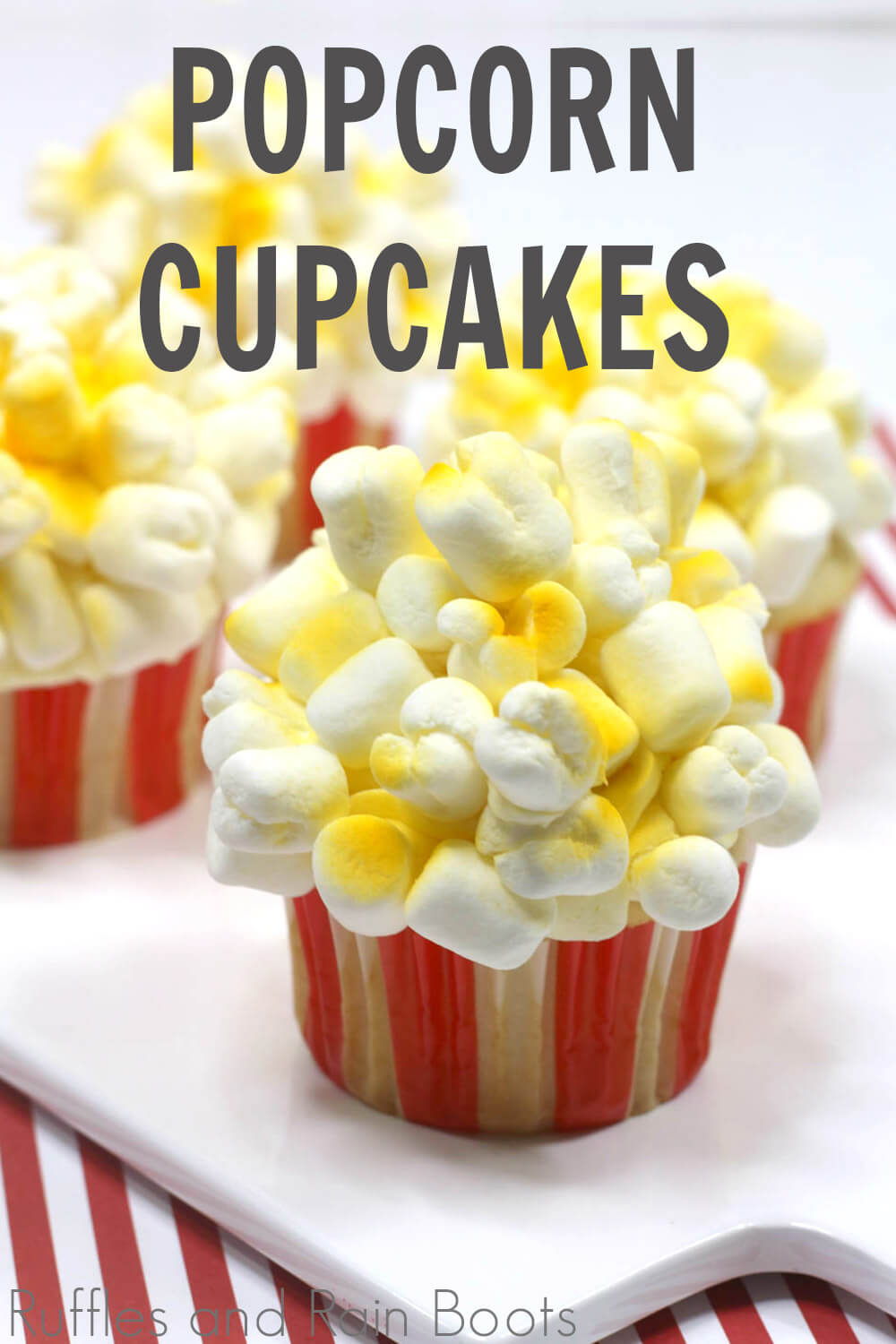 yellow and white fun popcorn cupcakes for party on a white board on a red and white background