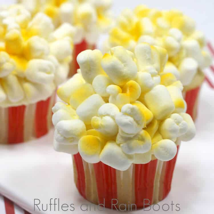 popcorn cupcakes on a white cheese board on a red and white background