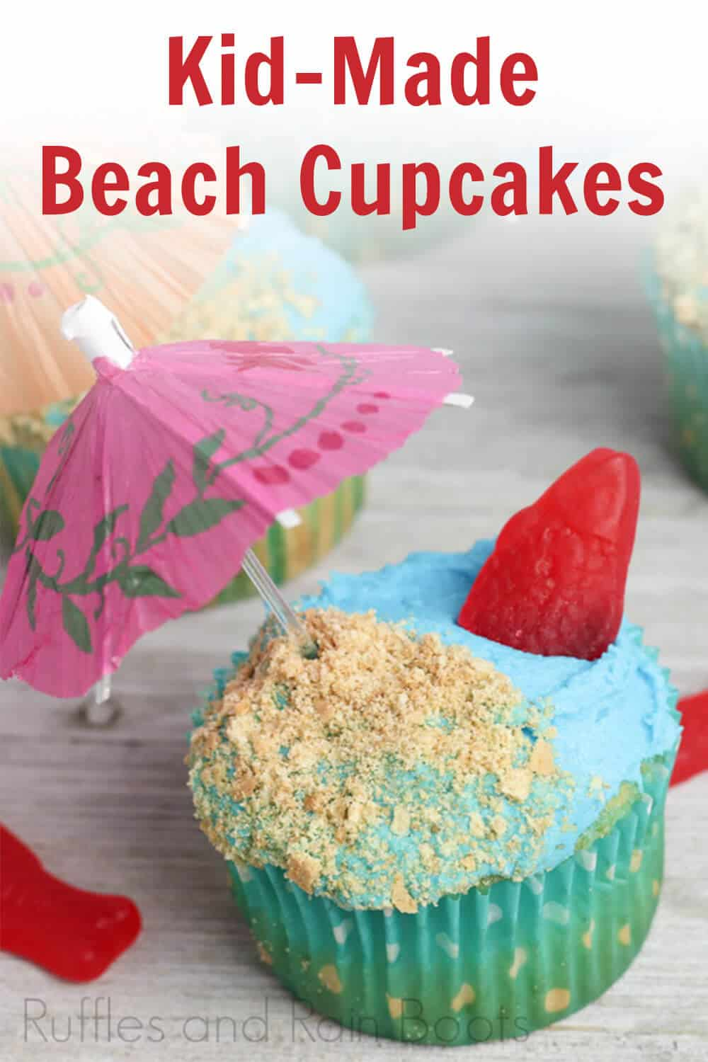close-up of single beach cupcakes for kids to make on a light beige background with scattered red candy fish with text which reads kid-made beach cupcakes