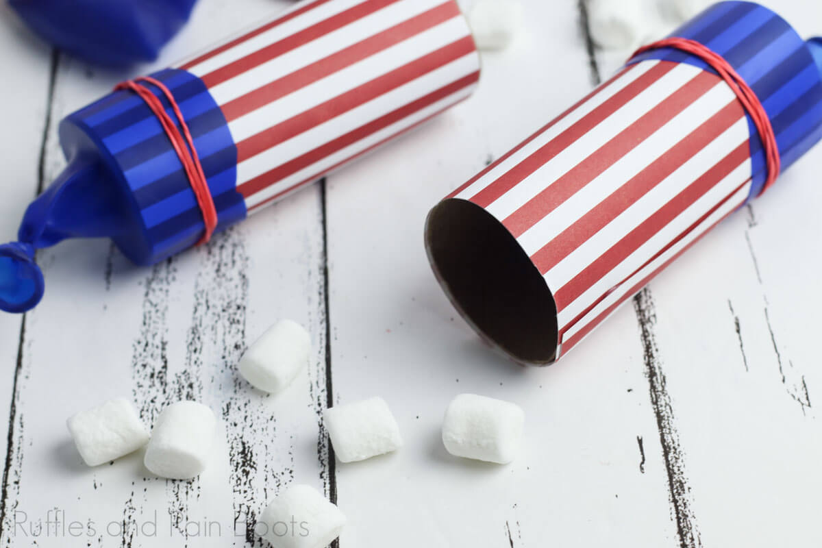 two marshmallow shooters launchers for the 4th of july on a wooden board