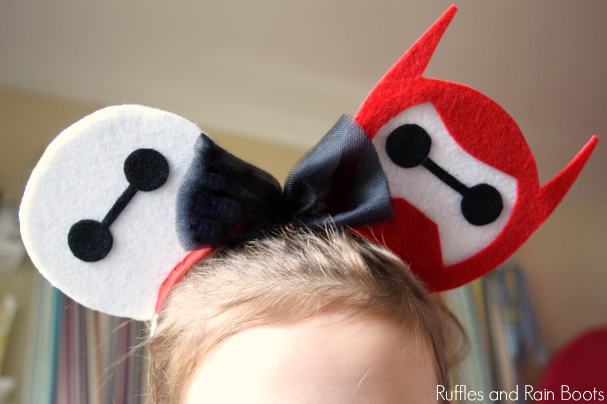 child wearing Baymax Mickey Mouse ears for Disney