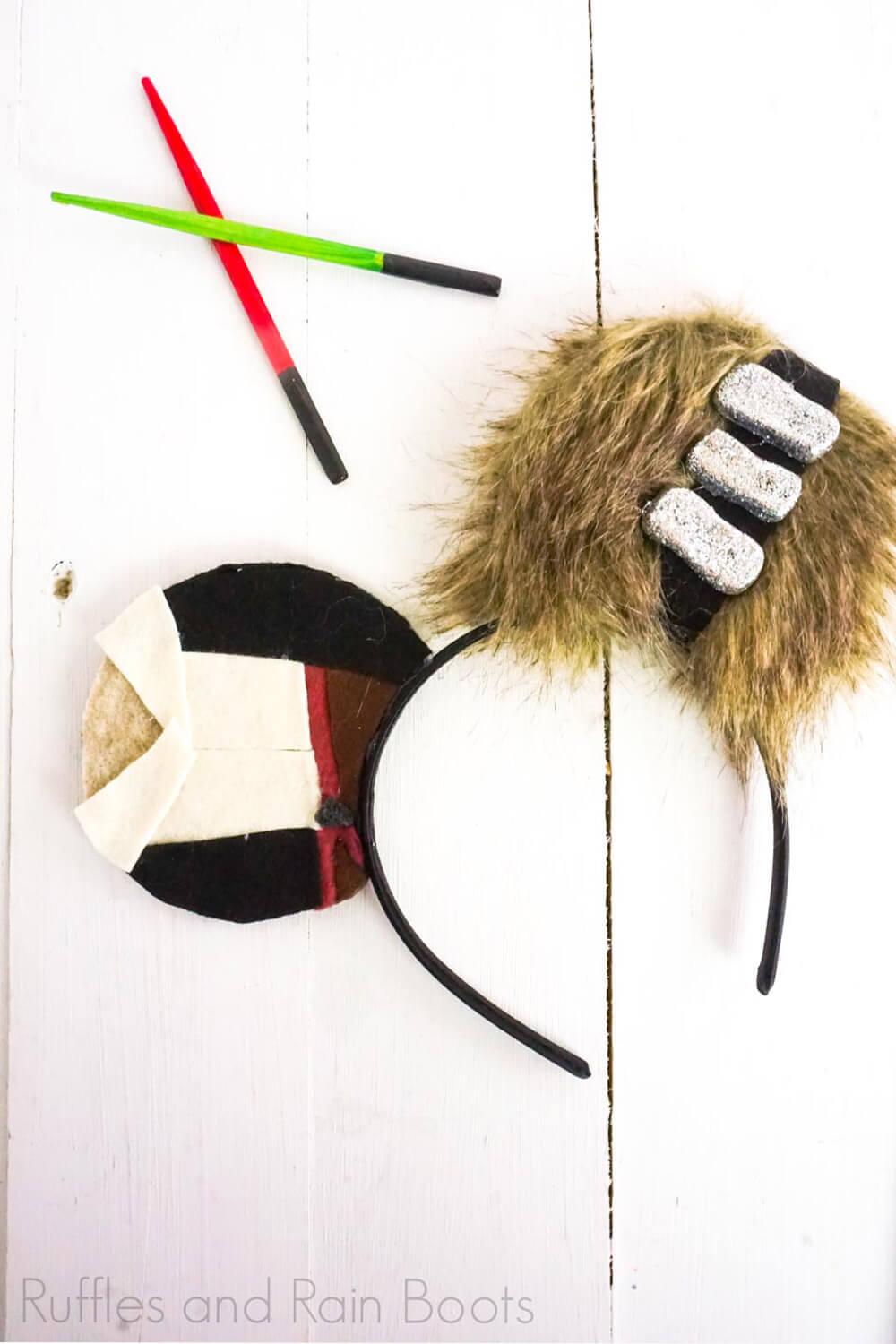 chewbacca and han solo mickey mouse headband on a white wood background with mini light sabers crossed in the background