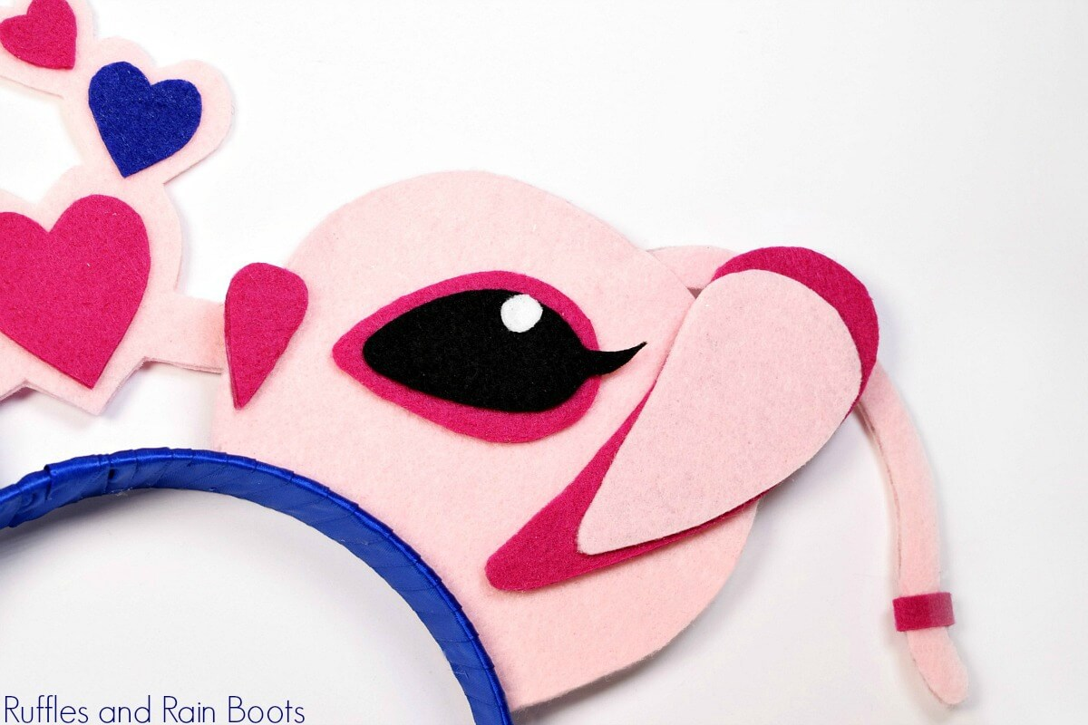 Disney's Angel Minnie ear close up in pinks from Lilo and Stitch on white background