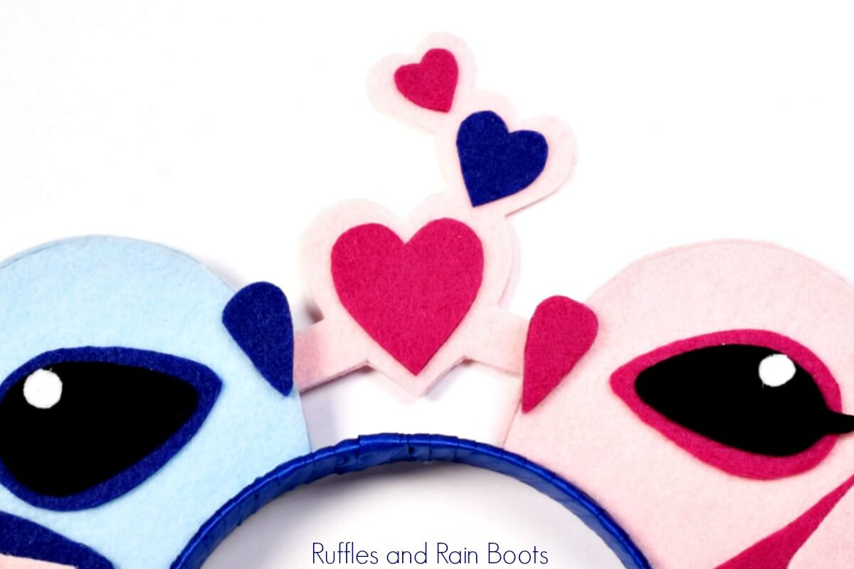 close up of Angel and Stitch Mickey Mouse ears in pinks and blues on white background
