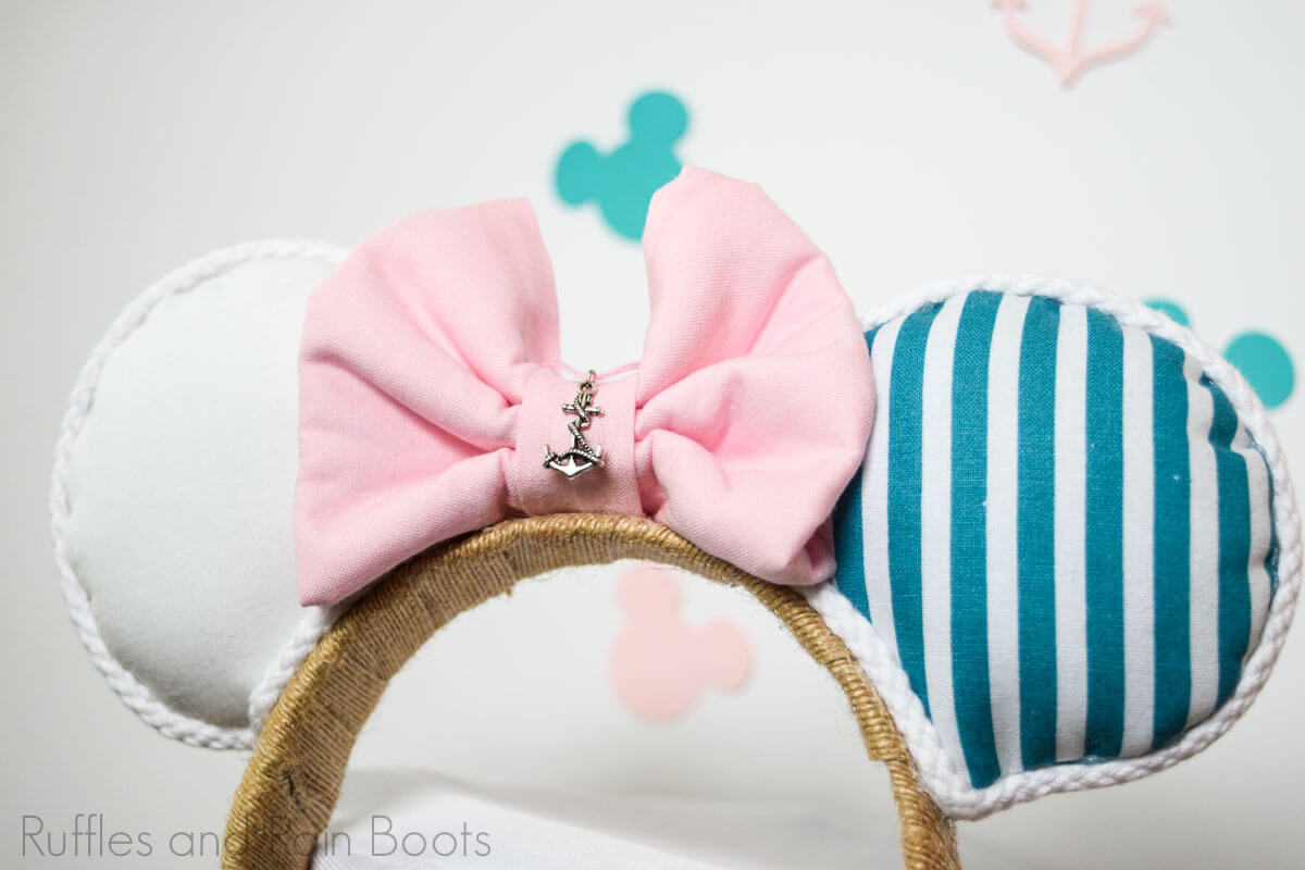 pink teal and white Minnie Mouse ears with nautical charm on white background