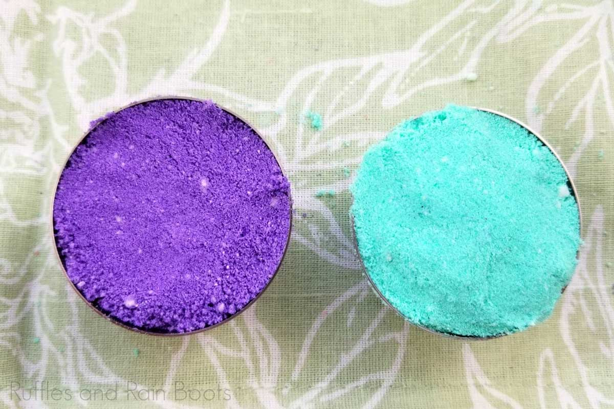 layer colors in bath bombs molds for little mermaid bath fizzies purple on one side and teal on the other on a light green table with leaf motif