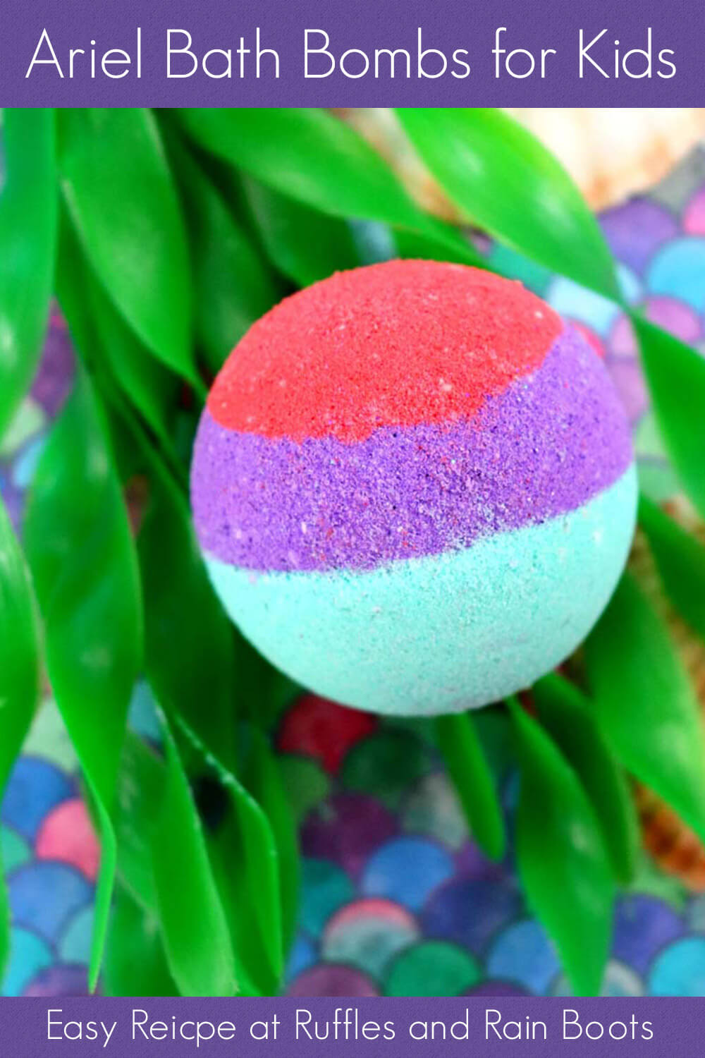 single red purple and teal bath bombs for kids ariel the little mermaid on fake sea grass with a shell sitting on a brightly colored scale-design table