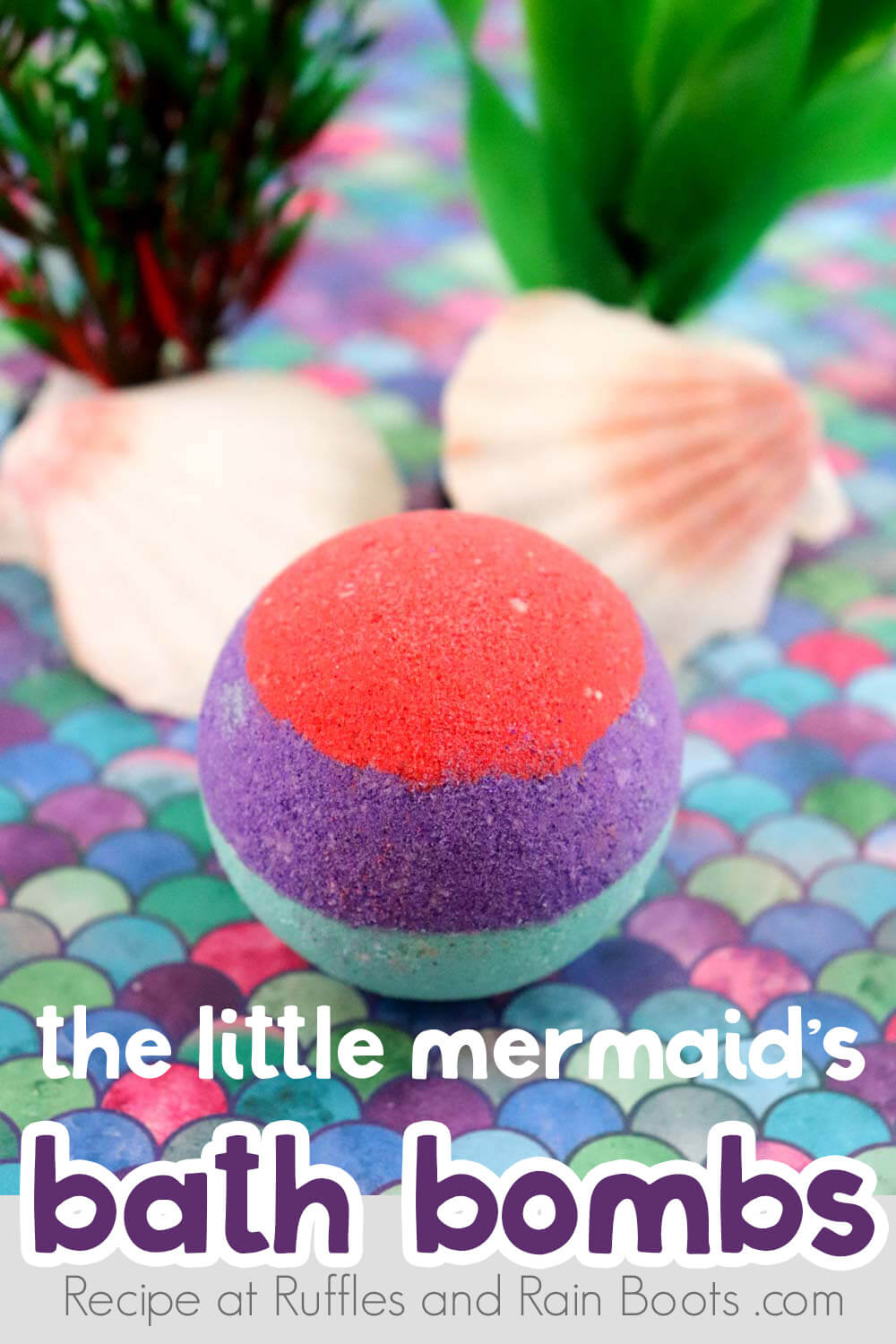 red purple and teal bath bomb on a colorful shell table with shells and fake sea grass in the background with text which reads the little mermaid bath bombs