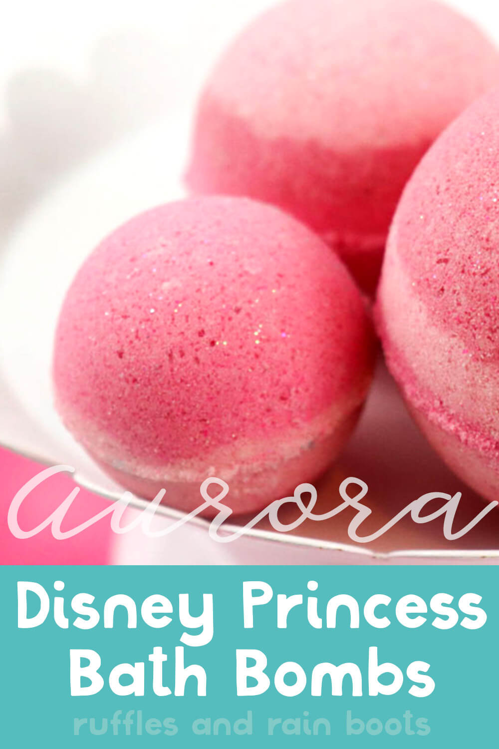 three pink striped aurora bath bombs for disney princess on a white cake plate on a pink table with a white background with text which reads aurora disney princess bath bombs