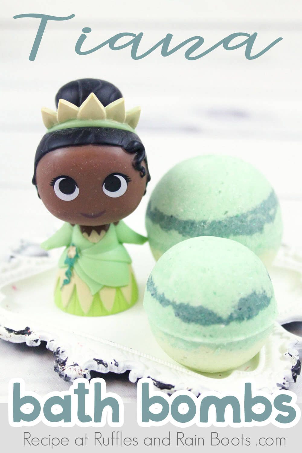 two adorable tiana bath bombs on a white antique plate with a princess tiana figurine on a white background with text which reads tiana bath bombs
