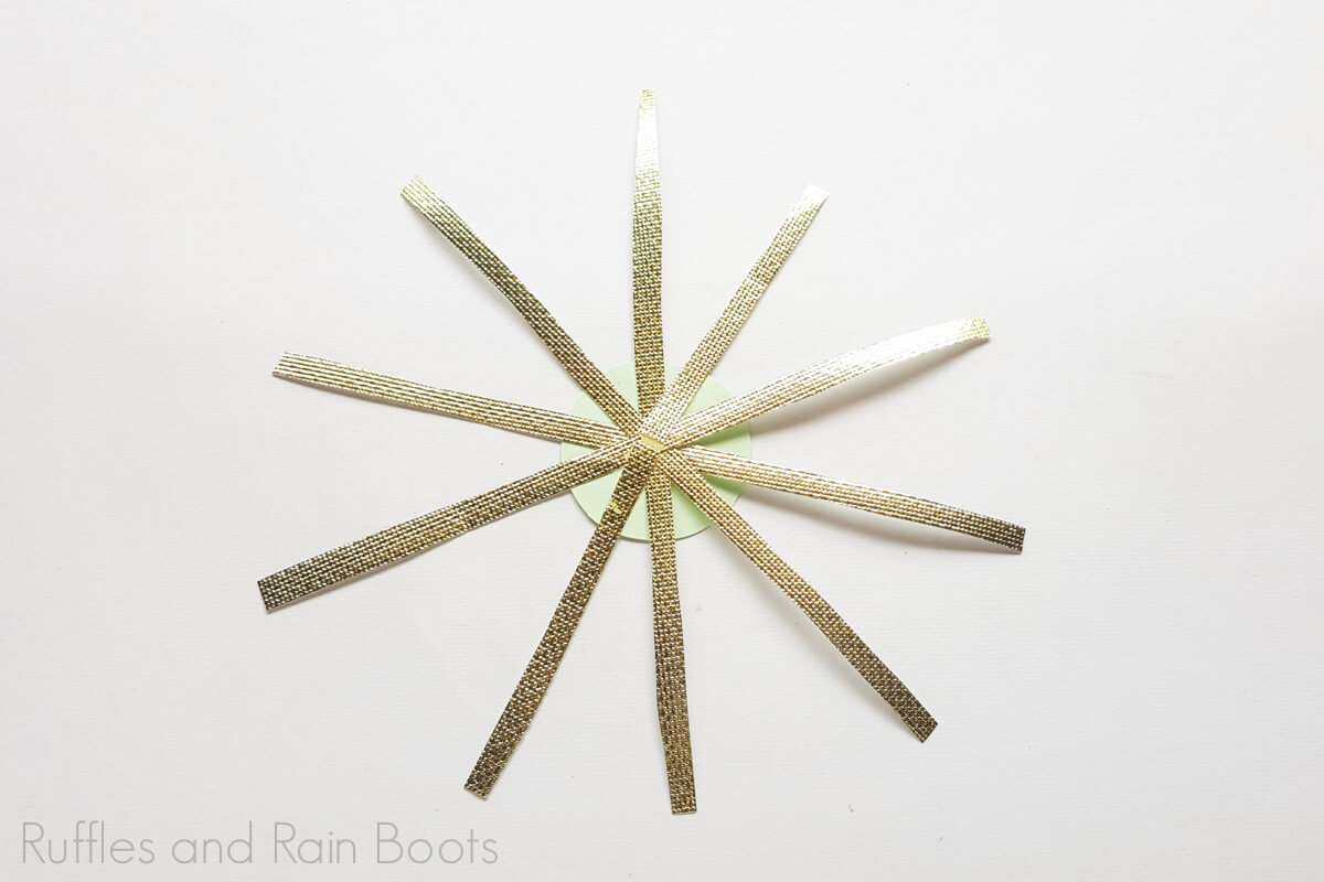 glue gold ribbons to the center cirlce