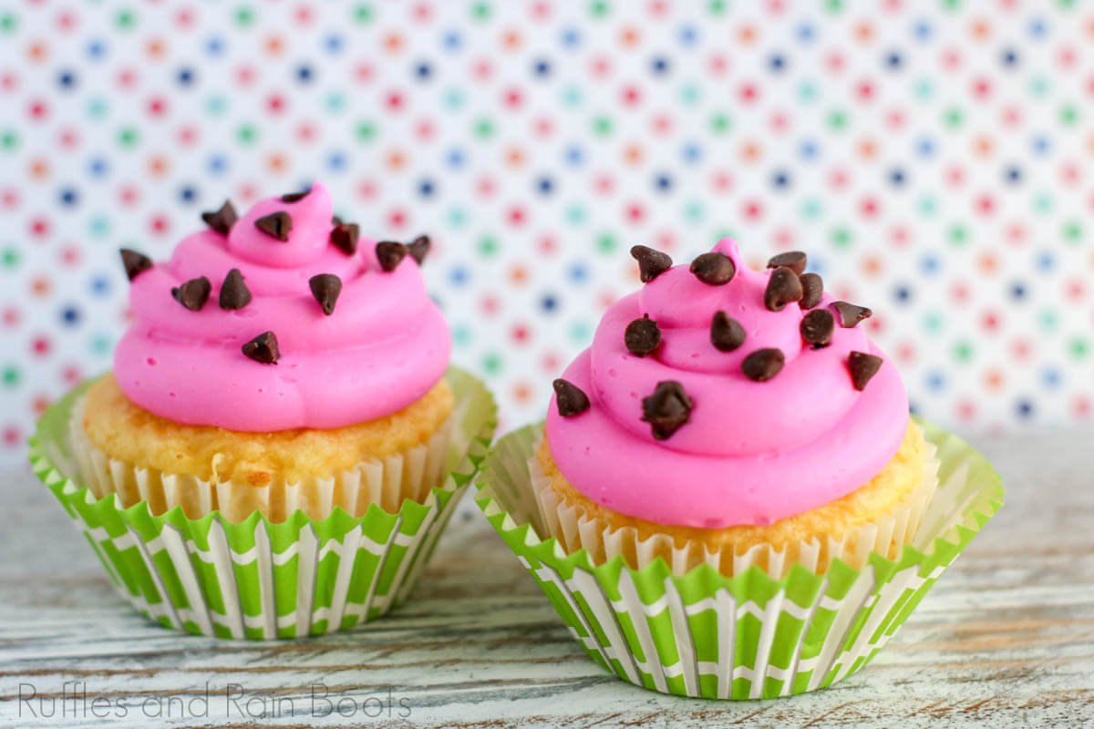two kid cupcakes watermelon cupcake idea on a wood table with a multicolored polkadot background