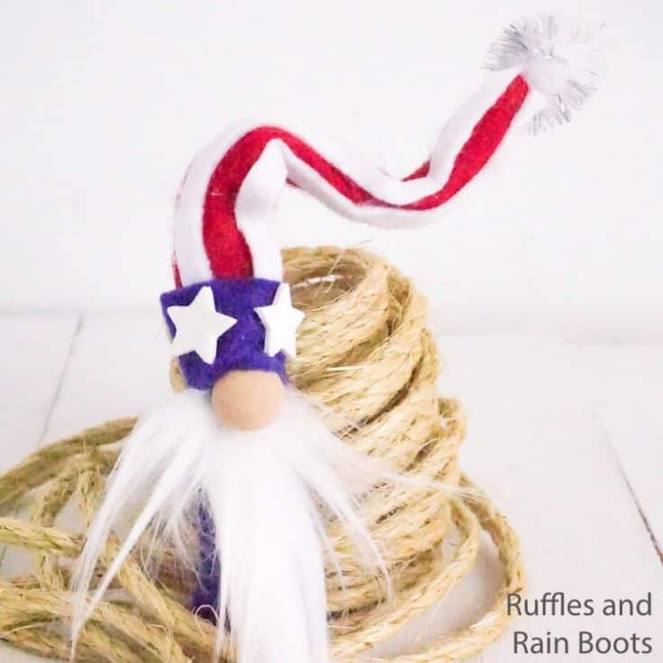 cute gnome for july 4th on a white wood table with a roll of twine
