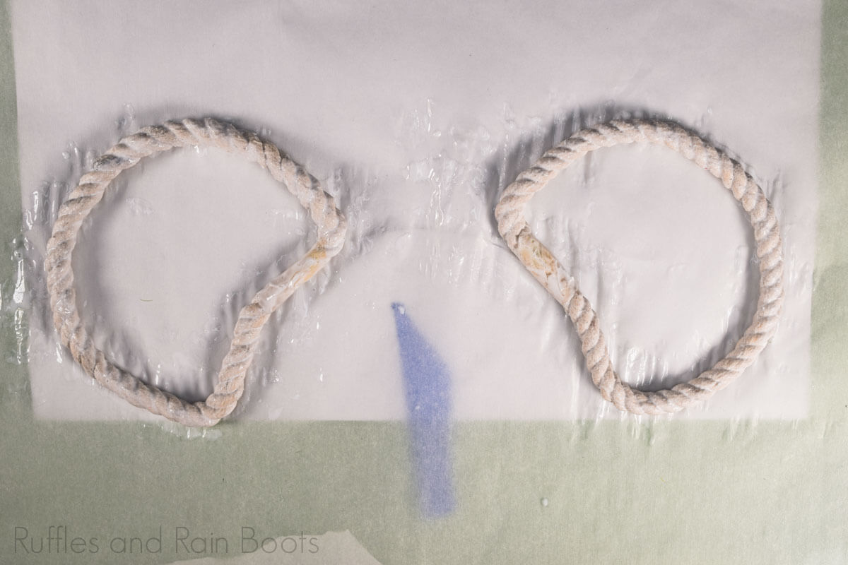 place glue soaked rope ears on parchment and leave to dry