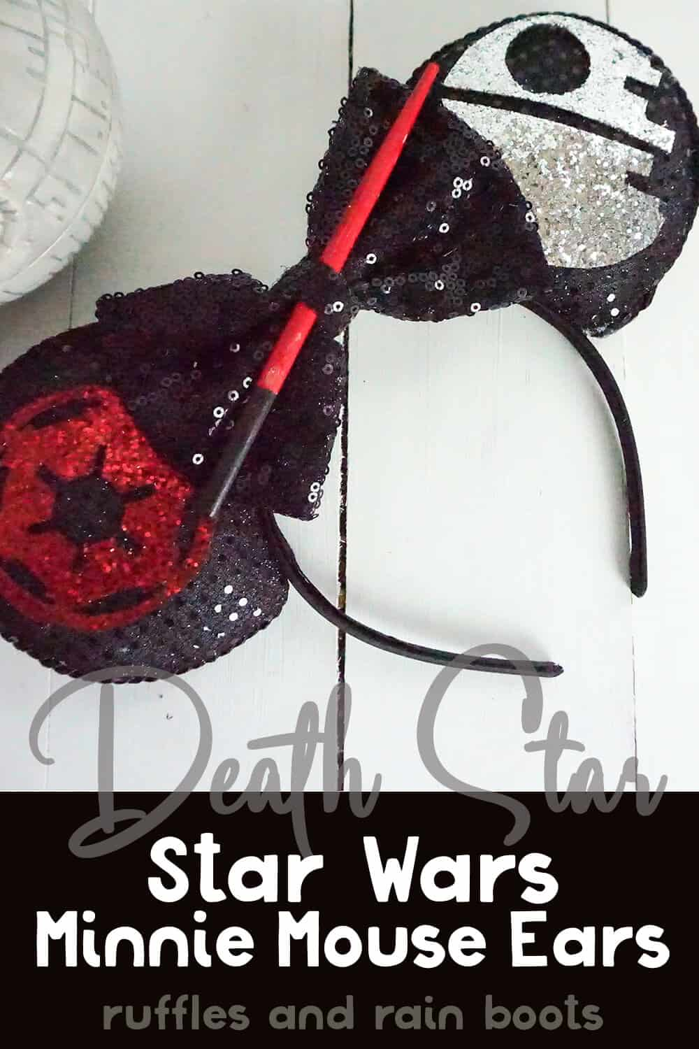 black mouse ear headband with star wars decorations on a white wood background with text which reads death star star wars minnie mouse ears