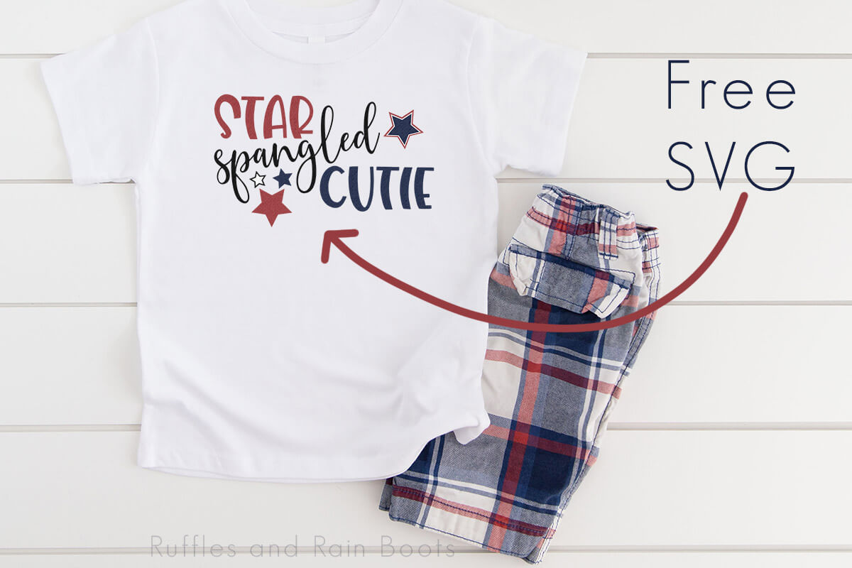 free svg for cricut cutie patriotic svg on white t shirt with red white and blue shorts on white wood background with text which reads free svg for cricut