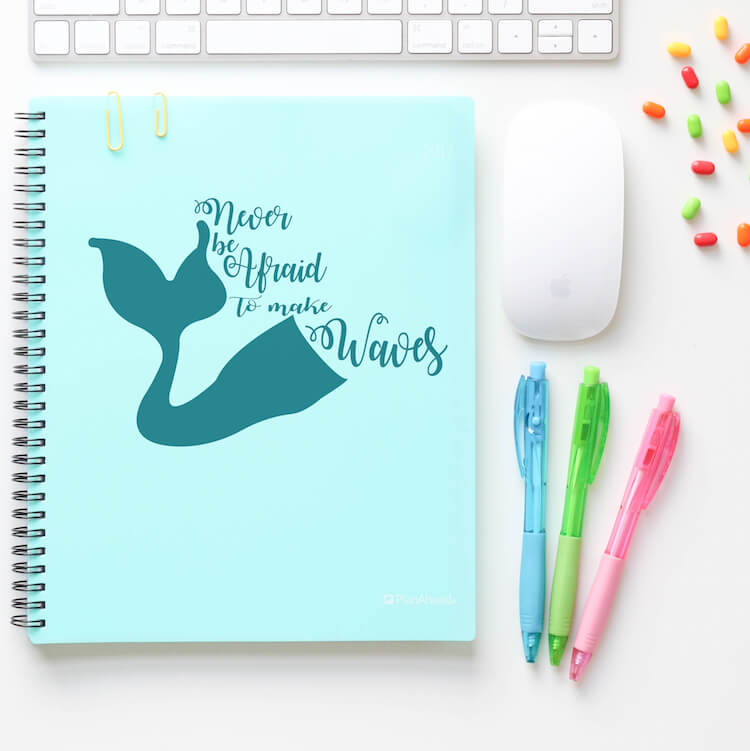 never be afraid to make waves free downloadable cut file on a blue notebook with other items on a white desk