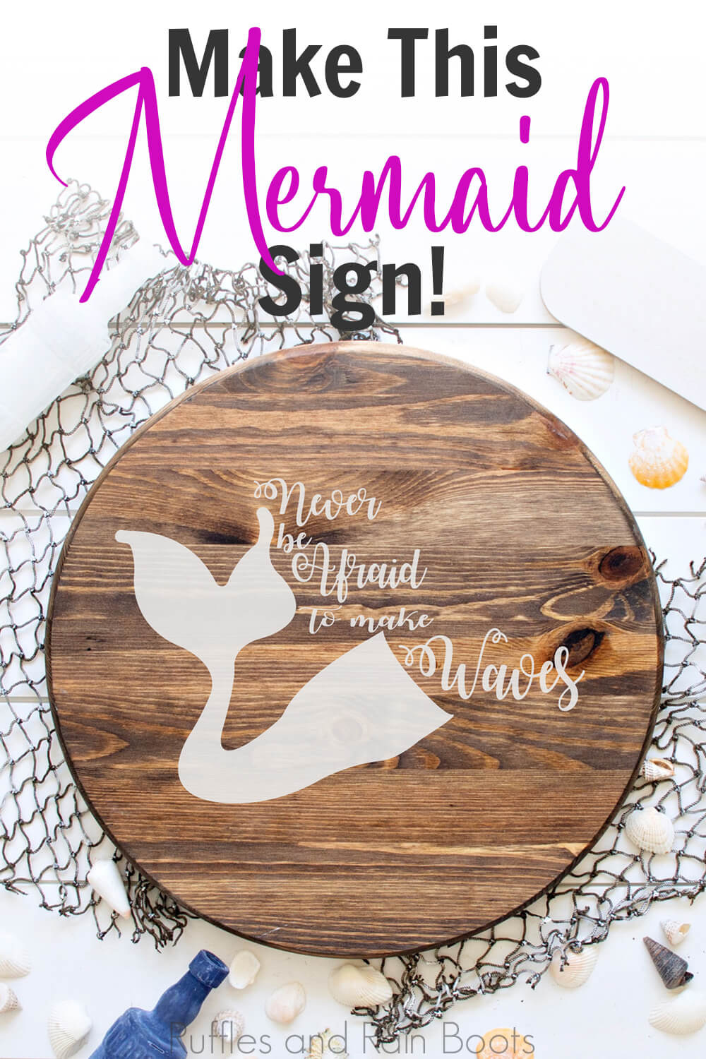 never be afraid to make waves free mermaid cut file on a round wood sign on a fishing net on a white wood background with sea shells, a blue bottle and oars scattered around with text which reads make this mermaid sign