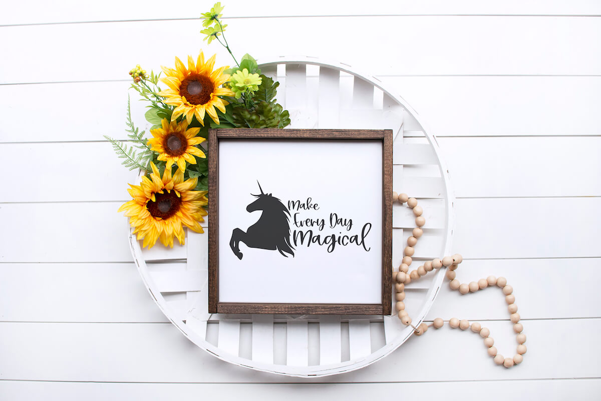 make everyday magical free unicorn cut file on pretty sunflower wall sign on a white wood background