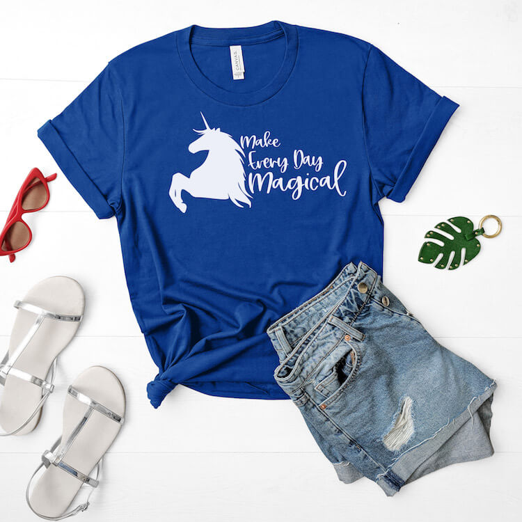 make everyday magical free unicorn cut file on blue t-shirt with jean shorts and sandals on a white wood background