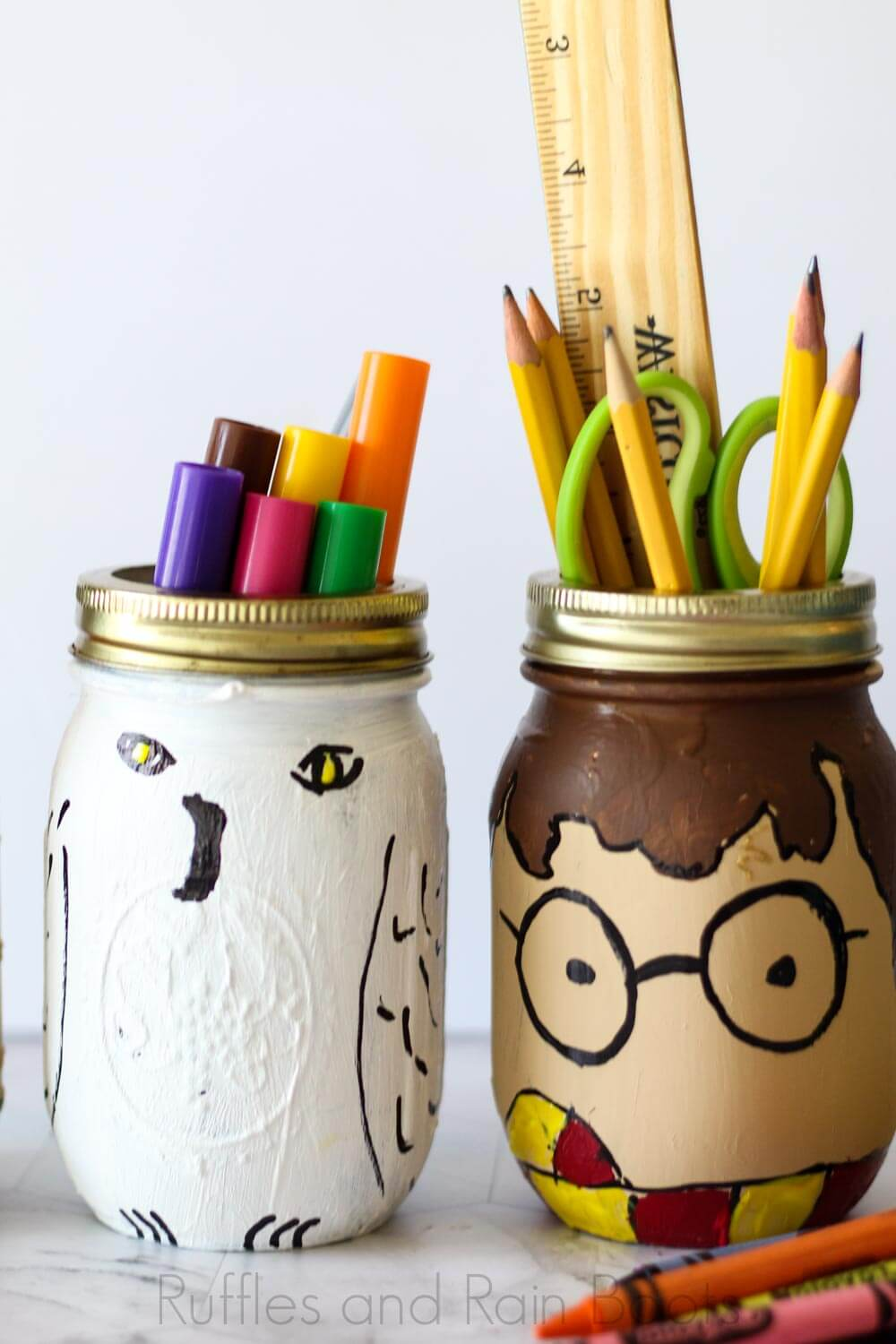 make harry potter school supplies with mason jars and paint on a white background