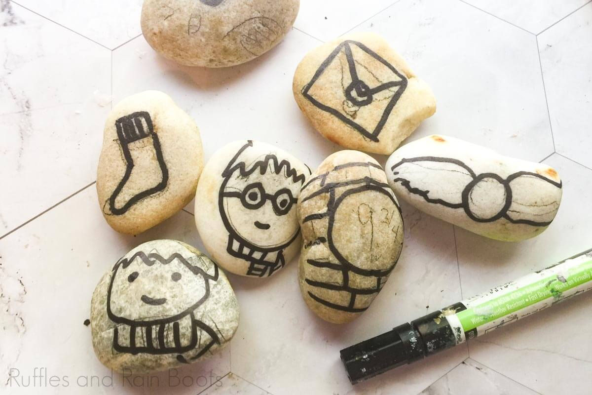 how to make harry potter story stones by outlining rocks in paint pen on a white background