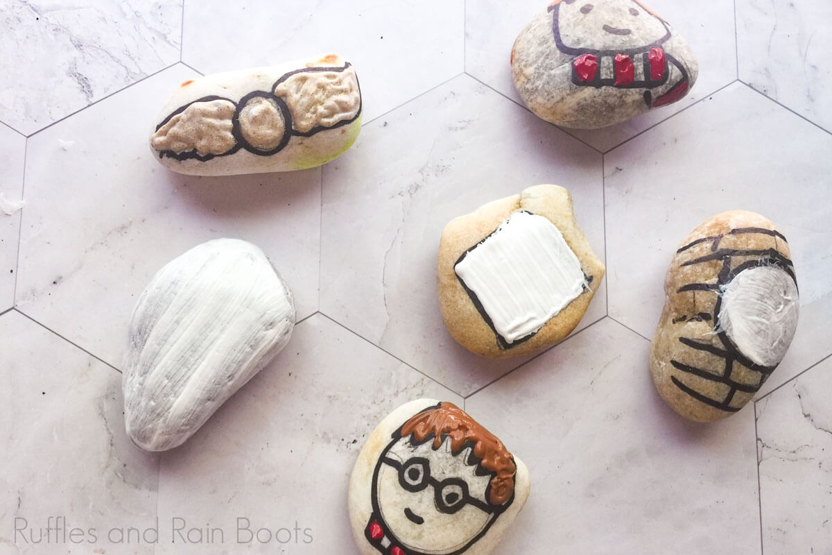 how to make harry potter painted rocks by filling base with white paint and paint on top
