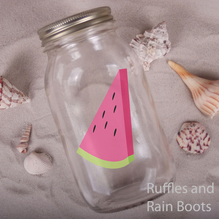 Watermelon Slice summer cut file on Ball Jar on a bed of sand with sea shells scattered around