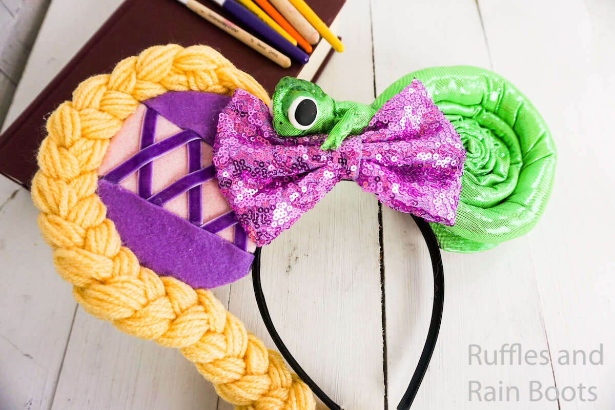 easy rapunzel mickey ears for disney on a white wood background with books and paint brushes