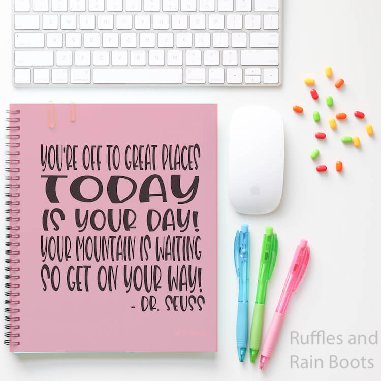 Dr. Seuss Quote back to school svg file on Notebook with pens a mouse keyboard and pushpins on a white table