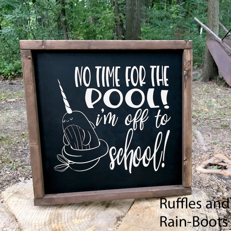 No Time for the Pool I'm Off to School Back to school svg file on a Chalkboard Sign on a rock outside