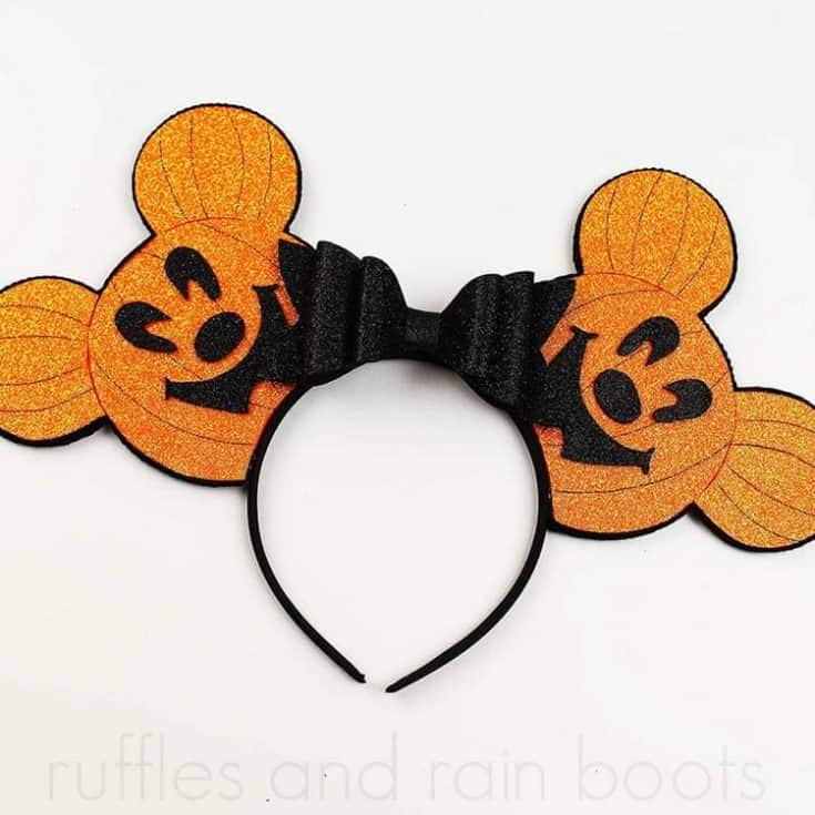 orange Mickey pumpkin head ears for Disney on white background with no text