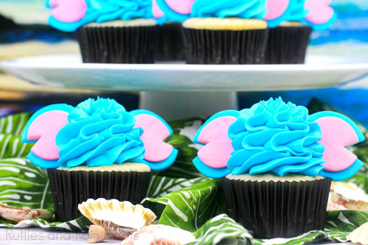 Stitch Cupcakes inspired by Lilo and Stitch on tropical party table with shells and palms
