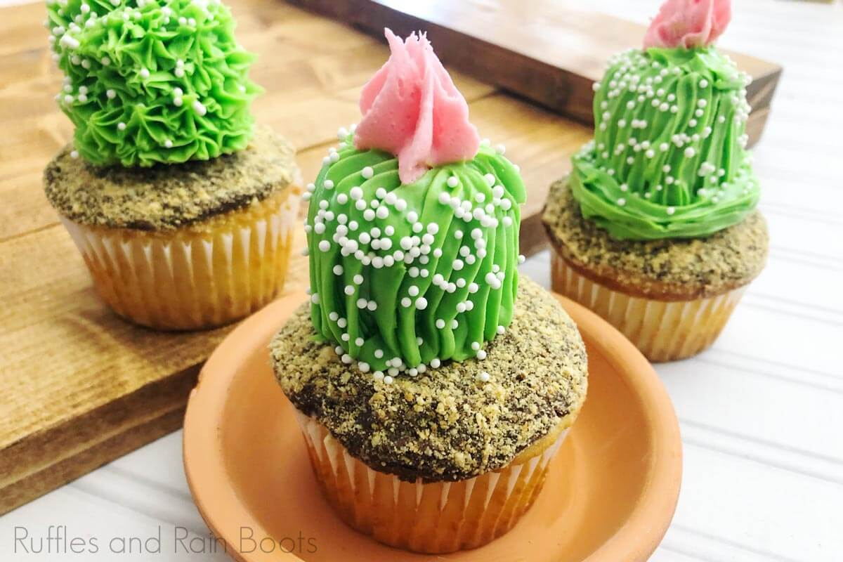 three Easy and Adorable Cactus Cupcakes for Party on a white wood background