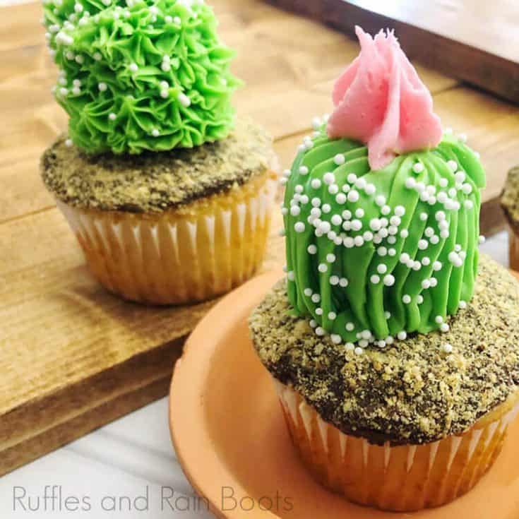 side view of Easy Cactus Cupcakes on a planter base on a wood background