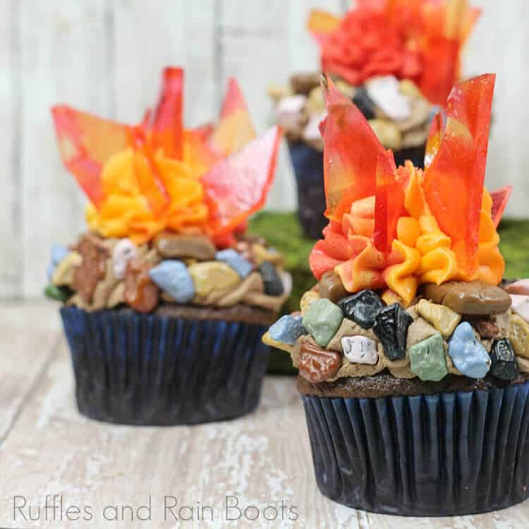 two Campfire Cupcakes Camping Cupcakes on a wood table
