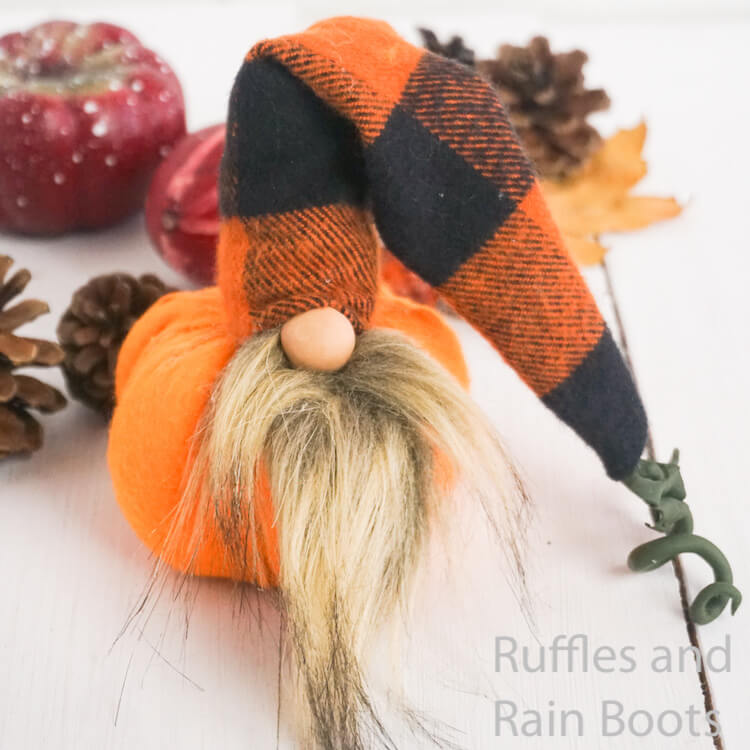fall pumpkin fall gnome on a white wood background